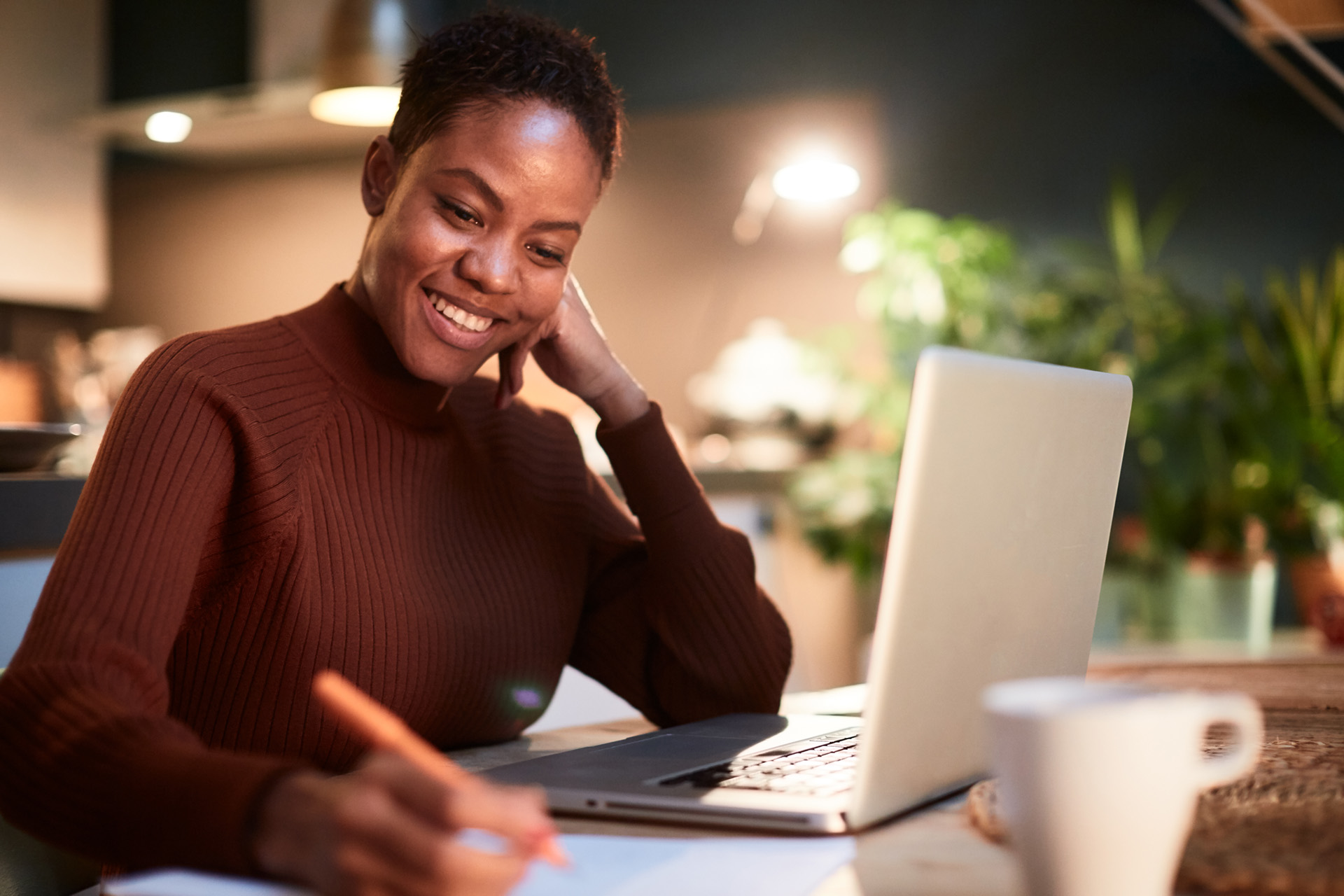 African American woman working hard at a computer