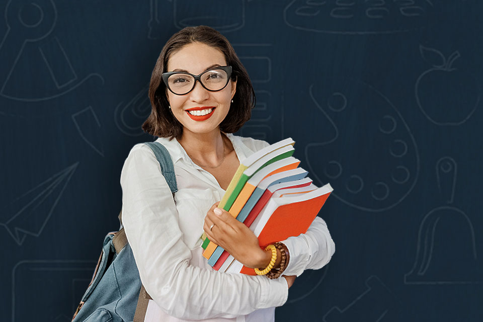 teacher holding a stack of books